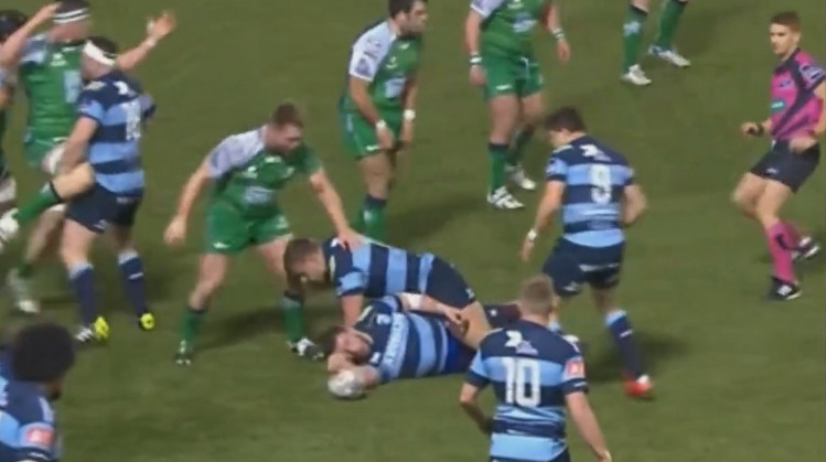 Alex Cuthbert knocks on out of the ruck into open play